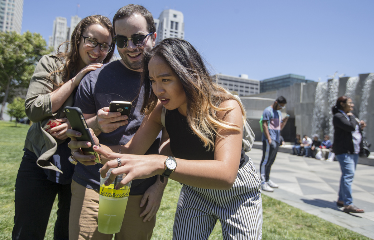 (From left) Michaela Wood, Michael French and Amanda Gomez search for Pokemon through the new Pokemon GO app at Yerba Buena Gardens in San Francisco, Calif. Tuesday, July 12, 2016. (Jessica Christian/S.F. Examiner)