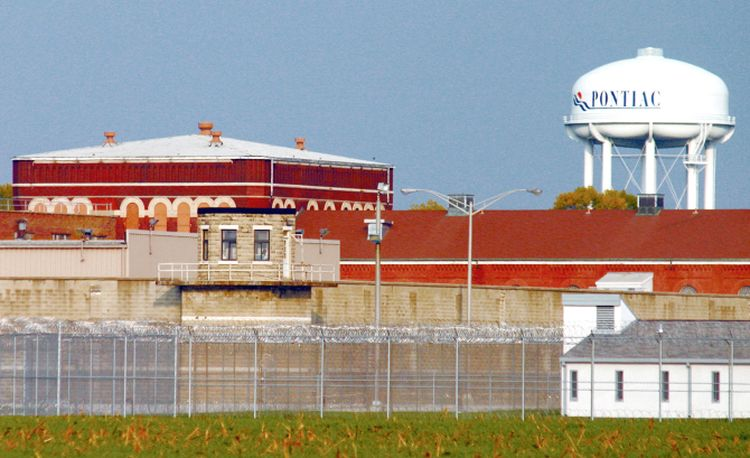 **FILE** This 2005 file photo shows the Pontiac Correctional Center in Pontiac, Ill. The Illinois Department of Corrections says it now wants to keep open a maximum security facility in Joliet, Ill., but close the prison in Pontiac. Corrections chief Roger Walker says inmates from Pontiac would be moved to a new jailhouse in Carroll County. (AP Photo/(Pontiac) Daily Leader, File)