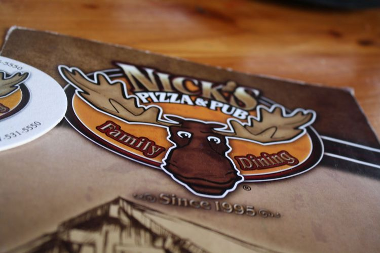 Nick's Pizza Pub menu logo