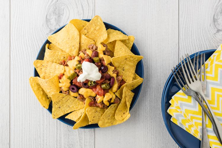Beef nachos with jalapeno, olives, tomato, beans cheddar cheese