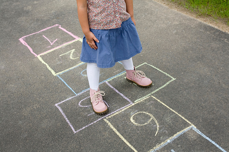 kids-playing-hopscotch-outside