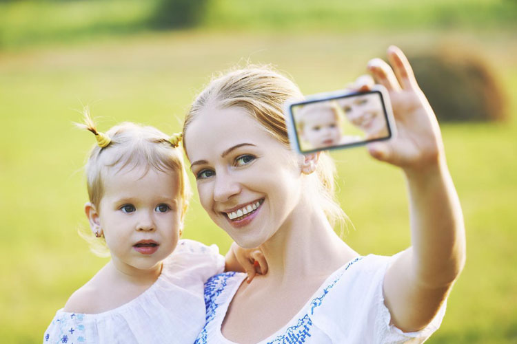 mother-baby-daughter-photographing-selfie-themselves-by-mobile-phone