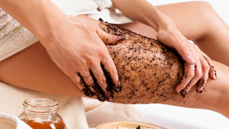Body care at home. Natural anti cellulite massage with coffee