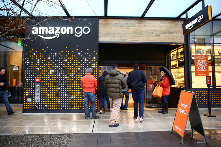 FILE PHOTO:    People are offered free reusable bags as they enter the new Amazon Go store in Seattle