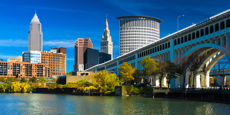 Downtown Cleveland with River, Bridge, Trees, and Deep Blue Sky